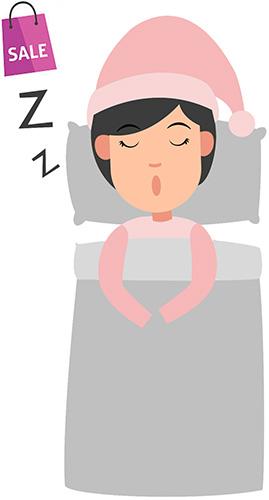Eine Frau liegt im Bett und träumt vom Sale